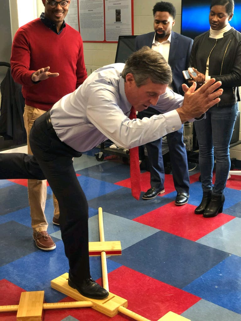 Gov. John Carney takes part in a balance simulation at Delaware State University with Homer.