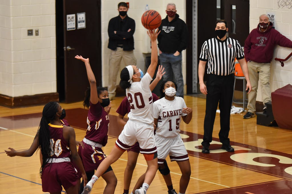 All eyes on India Johnston of Caravel as she releases a shot.