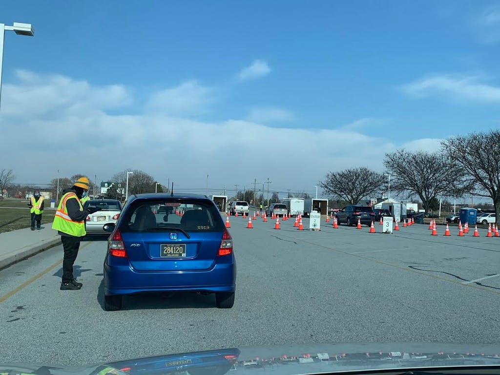 People line up for drive-thru COVID-19 testing at Middletown High School.