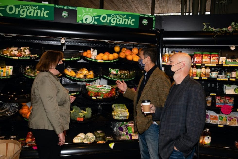 """Paula Janssen with Green Street USA's Alan B. Horowitz and Joel E. Fishman. """"We have always strived to be a good corporate citizen and community member,"""" she said of Janssen's Market. (Karen Gowen photo)"""