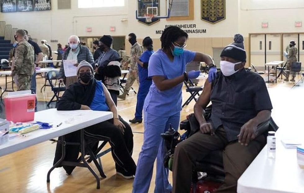 Older people got COVD-19 vaccine Monday at Salesianum School.