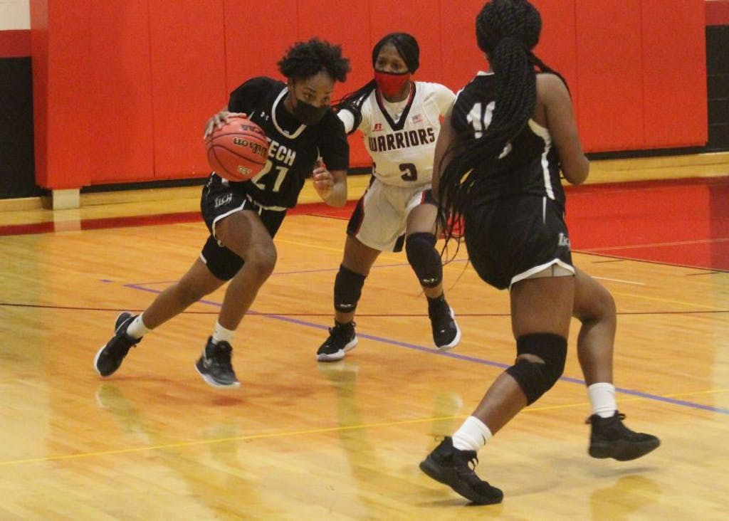 Maleyah Bell drives the ball against Wilmington Christian