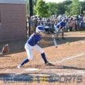 a baseball player swinging a bat at a ball