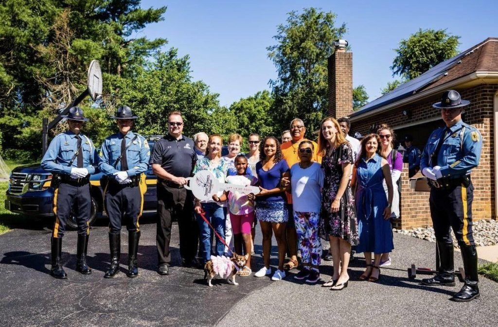 """Featured image for """"9/11 charity pays off mortgage for state trooper's family"""""""