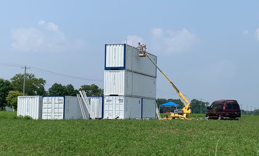 """Featured image for """"Cargo containers are stacked at site of new Bear Drive In"""""""