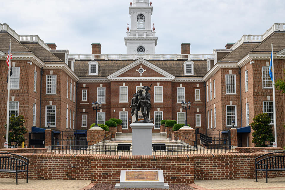 a bench in front of Delaware Legislative Hall