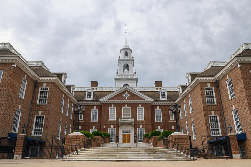 a large brick building with Delaware Legislative Hall in the background